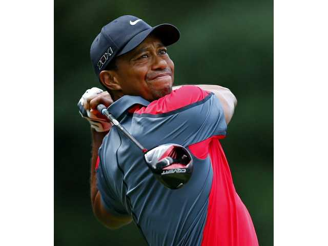 A solid start for Woods, the lead for Leishman
