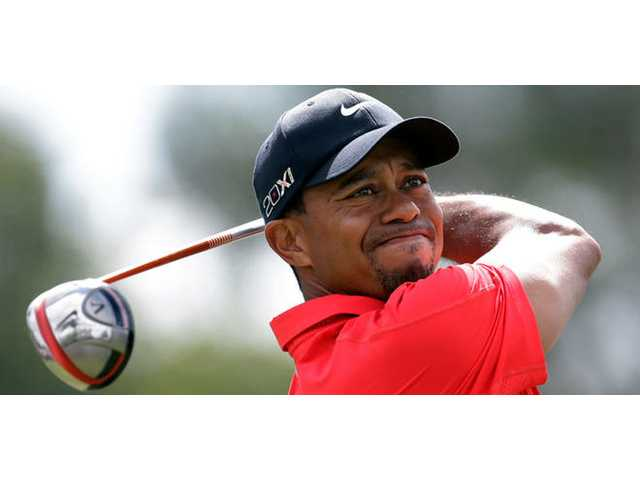 Woods, his game far from fit, struggles at PGA