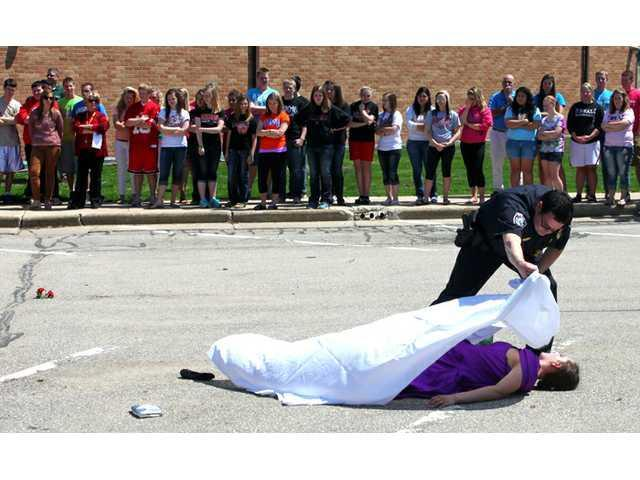 High school presents mock crash