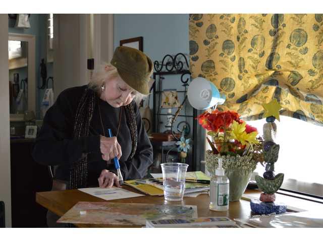 Retired educator tutors, paints in home art studio