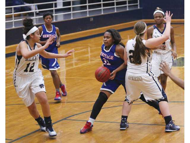 Much improved Lady Cats keep up