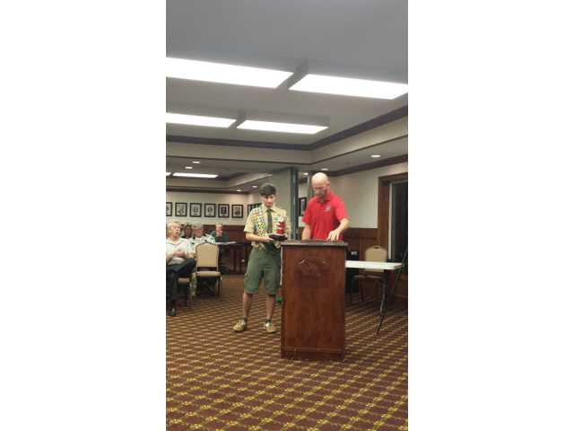 Eagle scout  candidate looks out for Winder firemen
