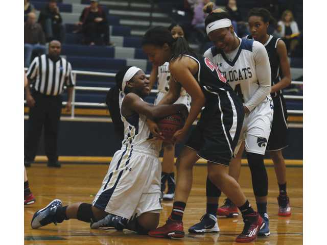 Lady Cats falter late in difficult contest