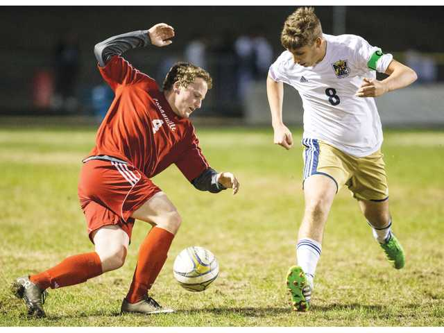 Cats outlast Red Devils