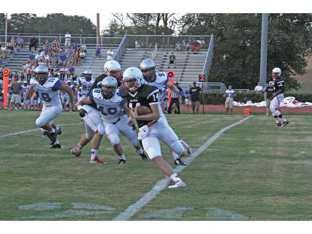 Overconfident Doggs brought down a notch in scrimmage