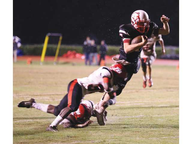 Sloppy field conditions not enough to slow down Winder-Barrow in win over Flowery Branch