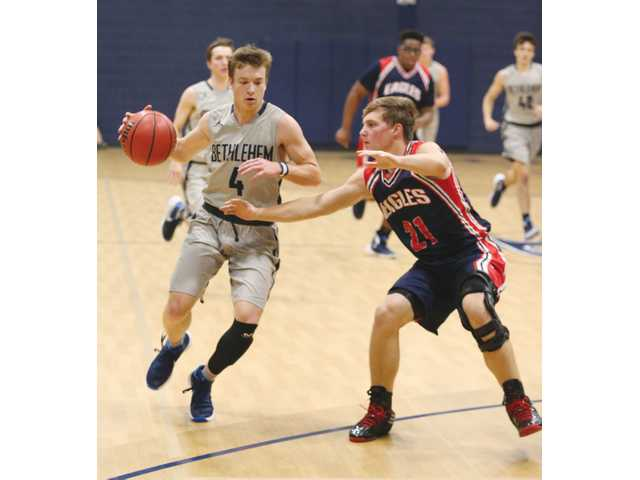 Knights outlast emotion to win inaugural performance in BCA's new gym