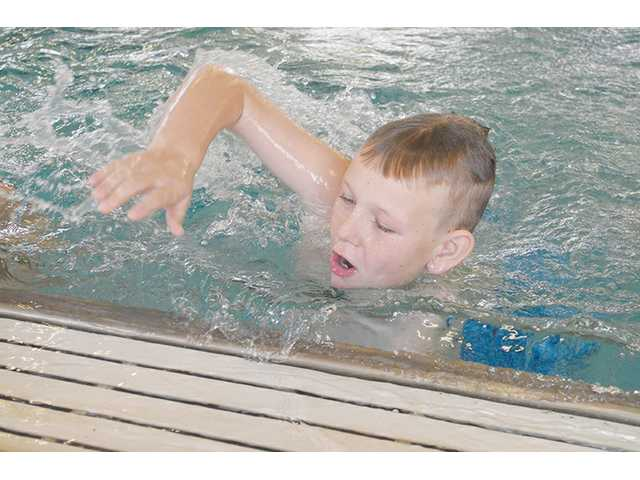 Local kids get free swim safety tips at YMCA