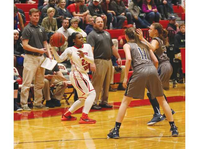 Lady Wildcat defense slows Lady Doggs, but does not stop them, in rivalry game