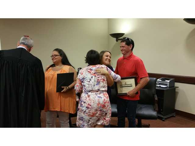 Second chance: Specialty Courts grads find happiness at graduation