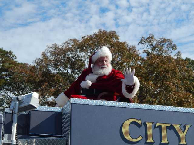 Santa Claus, on top of a Richmond Hill fire engine truck, greeted spectators at the 2017 Richmond Hill Christmas Parade. Photos by Mark Swendra