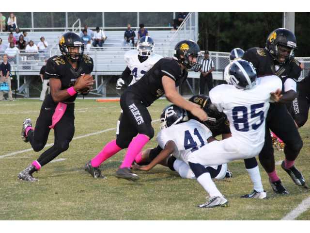 Hughes' five TDs lead Wildcats over Statesboro