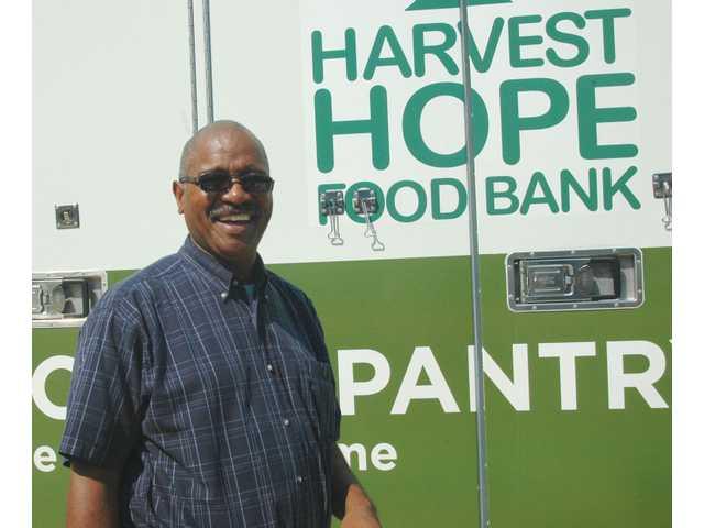Mobile food pantry visits Divine Faith Church