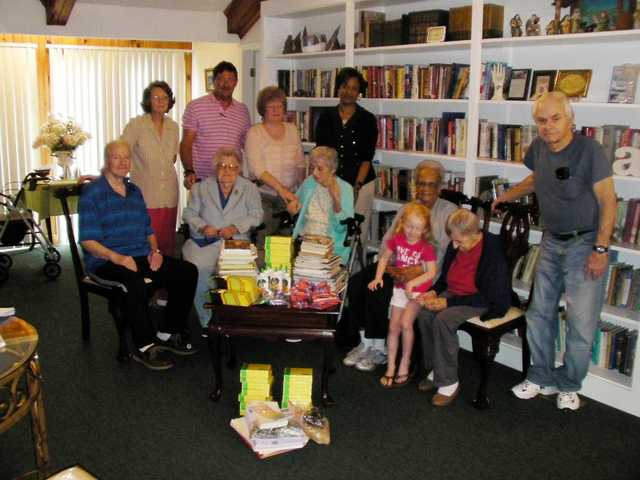 Ridgeway assisted living  home gives donation to LES