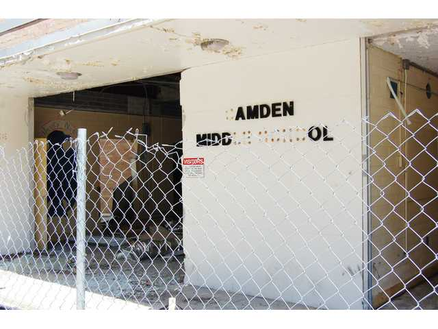 Asbestos abatement delays old CMS demolition
