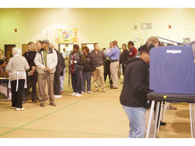 Absentee voting hits new record