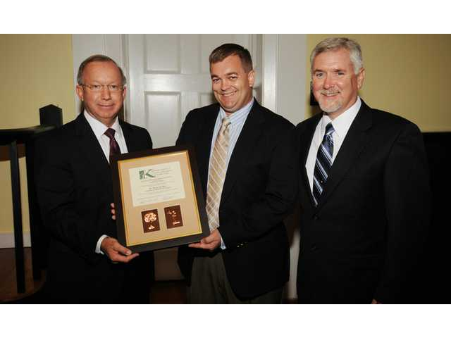 Chamber hands President's Award to Thiel Shull
