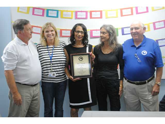 ALPHA Center employee honored for forty years of service