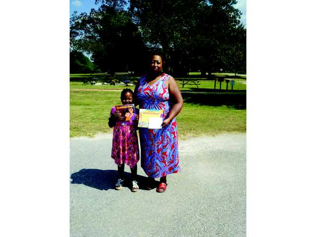 Local author selects winner of essay contest
