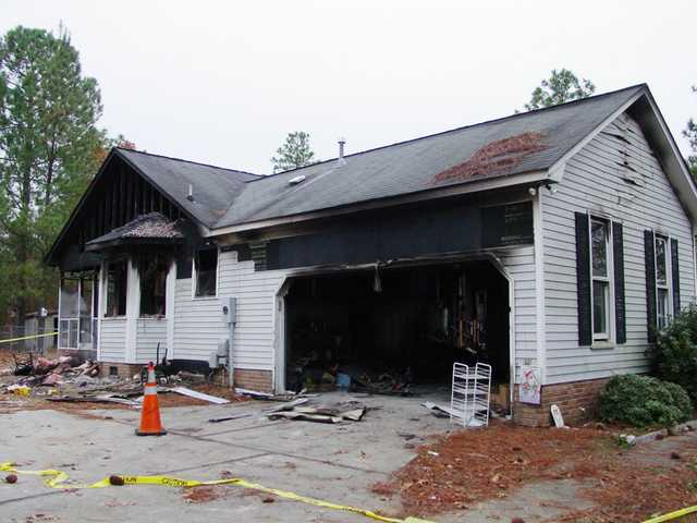 Woman burned in Lugoff house fire
