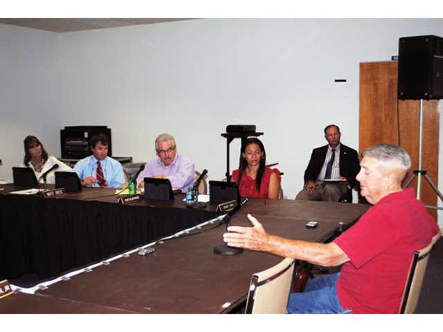 Board asks for clarification of language before voting