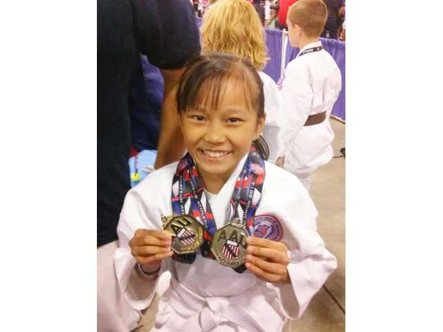 Wins double medals in karate tournament