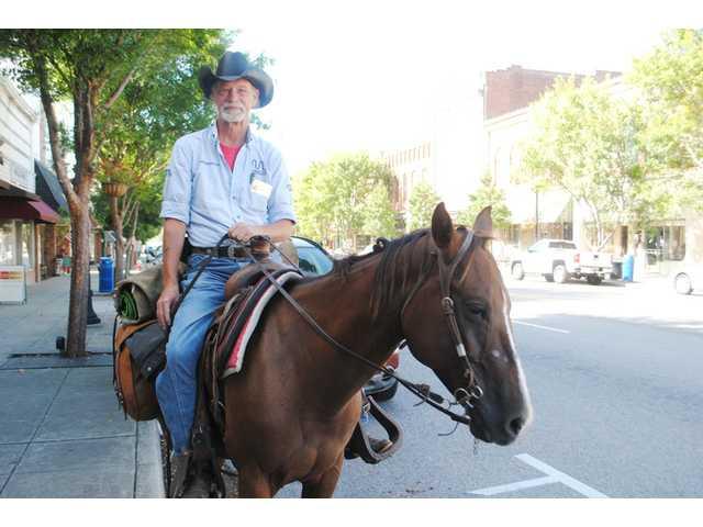 Texas man rides through Camden for stroke awareness
