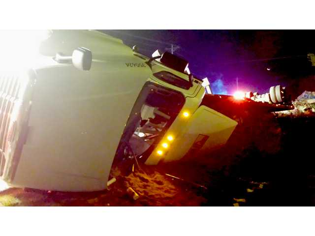 Driver injured when turkey truck overturns