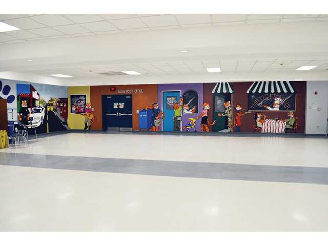 Stover Middle School students paint mural for school
