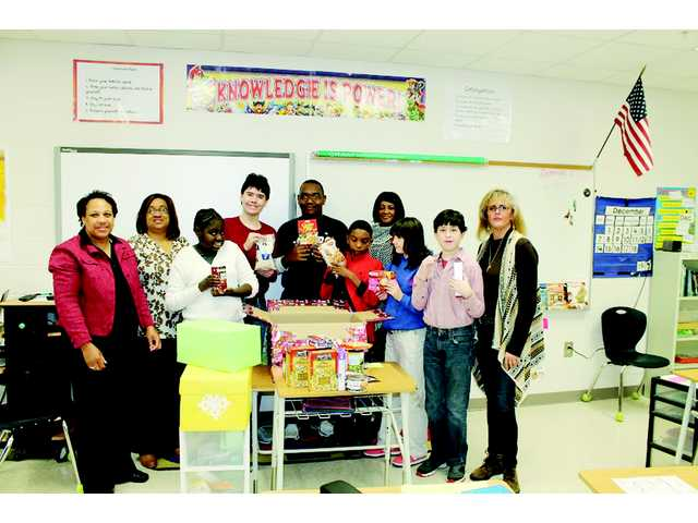 CMS students give to needy family