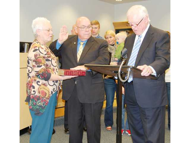 West takes oath as new coroner