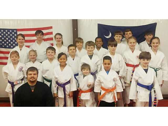 Karate kids strike it rich after a strong showing in Raleigh