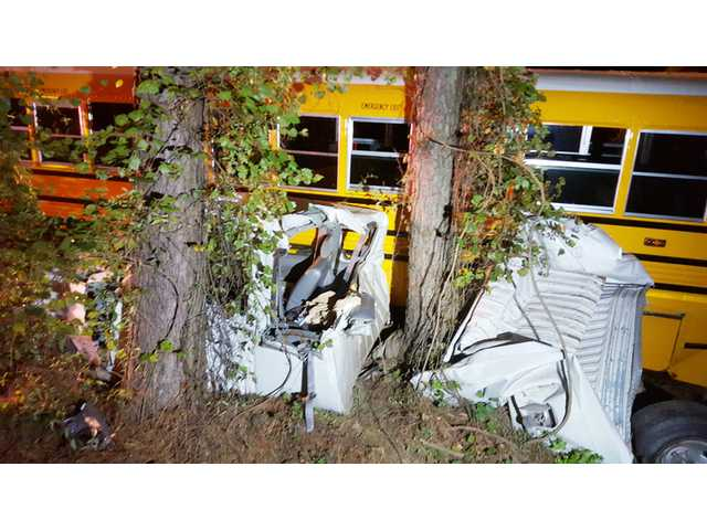 Pickup, bus crash sends two to area hospitals