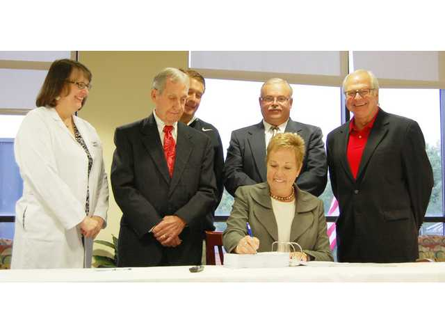 Signing day for KershawHealth board chair
