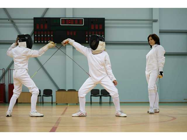 What it's like for a dad to raise a fencing prodigy