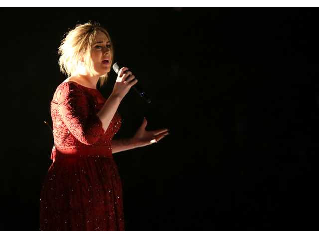 Adele fixes performance glitches with a burger and a shake