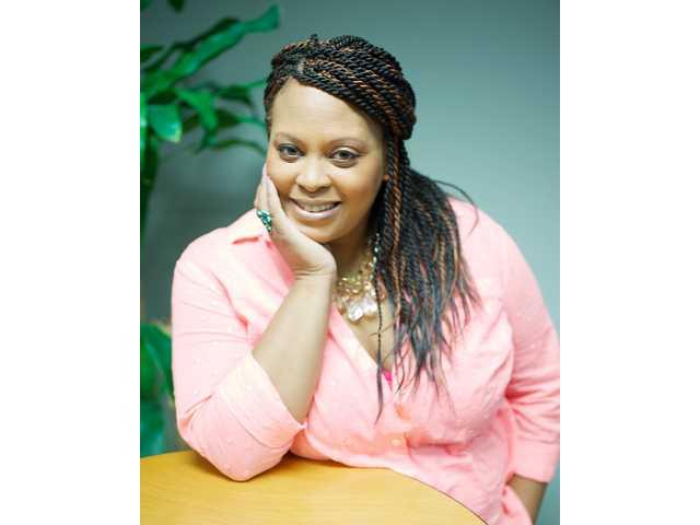 Elgin woman recognized for superior customer service