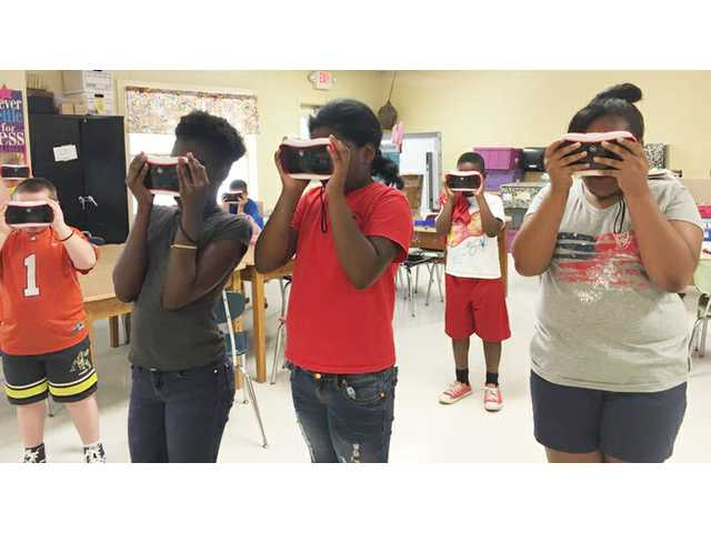 BDK students using Google Expedition goggles