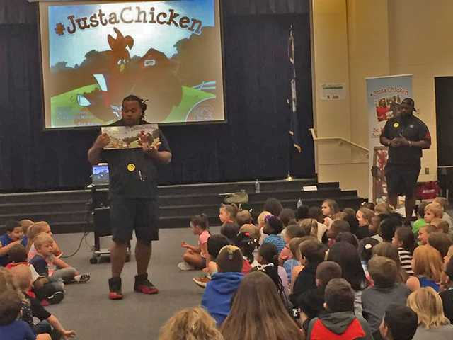 Former USC football players visit DME students