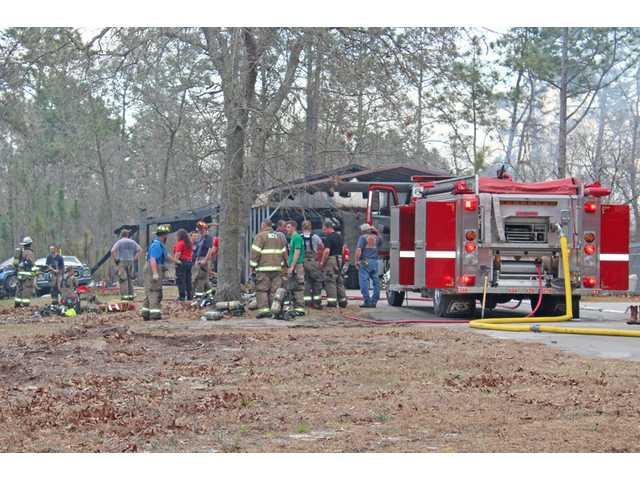 Firefighters respond to garage fire in Cassatt