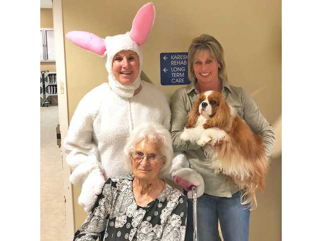 Easter Bunny and Uno visit Karesh residents