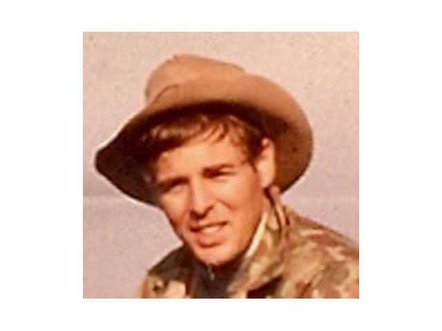 RAYMOND G. WOOLFE JR.