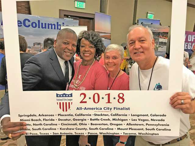 A hearty 'welcome home' for All-America City delegates