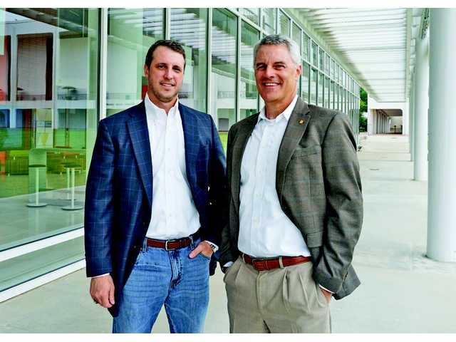 Camden natives join forces to help executives, business owners