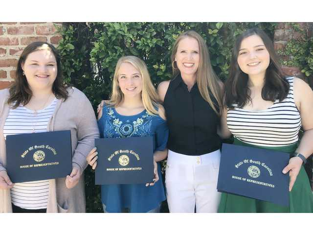 Three students earn scholarship