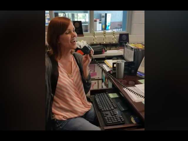 The Clean Cut: High school receptionist belts incredible version of 'At Last' over PA system