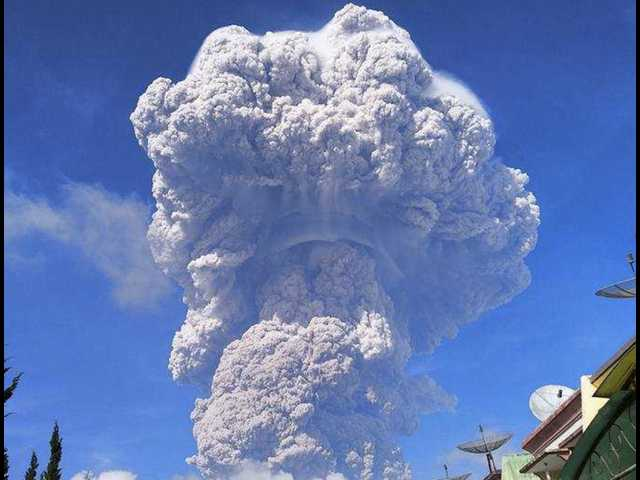 Videos and photos show volcano eruption that left a mountain peak 'completely annihilated'
