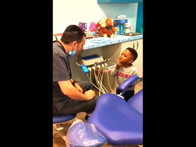 Have You Seen This? Dentist's magic show makes kid's day