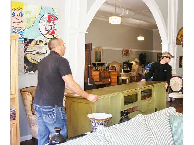 ... Aaron Thompson Carry A Big Mid Century Stereo Console Into Humble  Abodes On Opening Day. The Shop Owned By Aycock And Erin Dalton Offers Used  Furniture ...