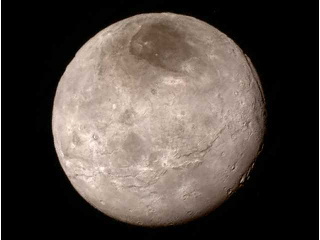 Peaks on Pluto, canyons on Charon